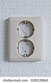 Safety socket on a white wall