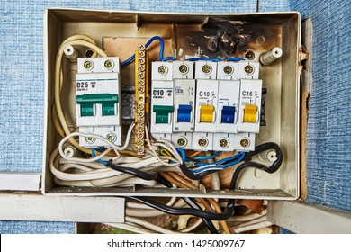 Safety switch problems, old burned electrical switchboard and circuit breakers located in residential building.