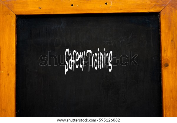 Safety Training -  Hand writing word to represent the meaning of Business word as concept.