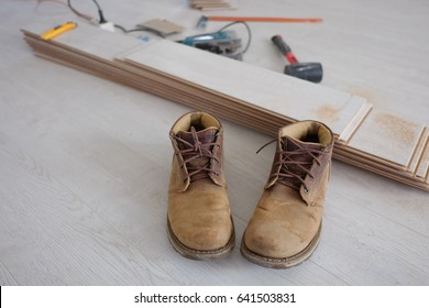 safety working boots on laminate