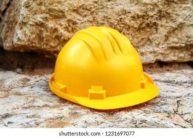 Safety Works, Building: Hard Hat, Construction Hat Helmet. Background for construction worker or engineer helmet - natural stone