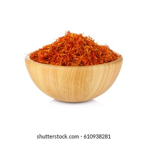 Safflower in a bowl on white background