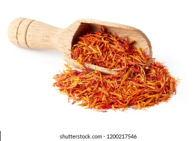 Safflower petals (Saffron substitute) in wooden scoop isolated on white background
