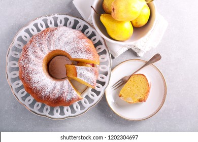 Saffron bundt cake with pears, served on table