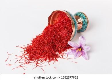 Saffron in cup and saffron flower