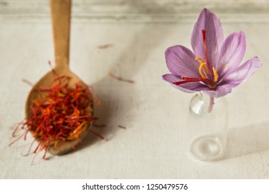 Saffron flower and spoon with saffron types
