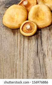 Saffron milk cap mushrooms on wooden table. Copy space