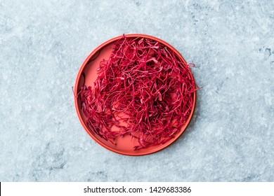 Saffron in Red Plastic Cup /Red Threads Kesar, Saffron, Crocus Sativus. Organic Product.