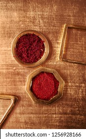 saffron space threads and powder  in golden case on festive background