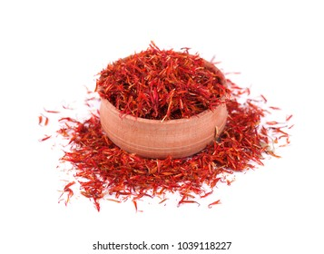 Saffron spice in wood bowl isolated on white background.
