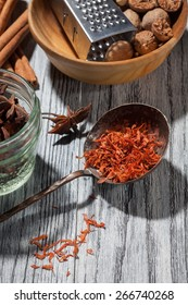 saffron with various spices on wooden background - anise, cinnamon, ginger, nutmeg,