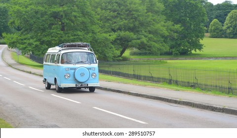 SAFFRON WALDEN, ESSEX, ENGLAND - JUNE 21, 2015: ClassicLight Blue & White Volkswagen Camper Van on country road.