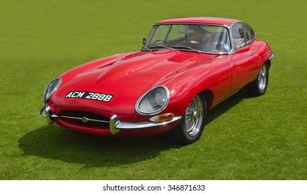 SAFFRON WALDEN, ESSEX, ENGLAND - JUNE 21, 2015: Classic Red E - Type Jaguar in vintage car Show.