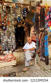 SAFRANBOLU, KARABUK, TURKEY - 30 June 2013. A view from Safranbolu streets. An old man is sitting in front of a souvenir shop.