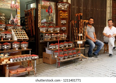 SAFRANBOLU, KARABUK, TURKEY - 30 June 2013. A view from Safranbolu streets. Two men is sitting in front of a souvenir shop who sell models of traditional Safranbolu houses.