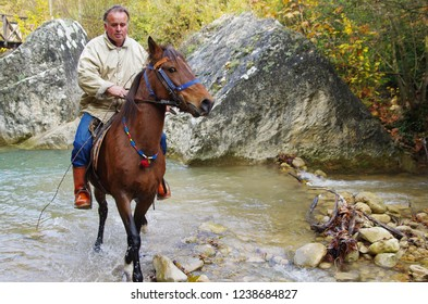 Safranbolu, Kastamonu / Turkey - November 15 - 2015 : Horse trainer man riding the horse in river