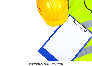 Saftey yellow hi vis vest and hard hat with a blue clipboard isolated on a pure white background