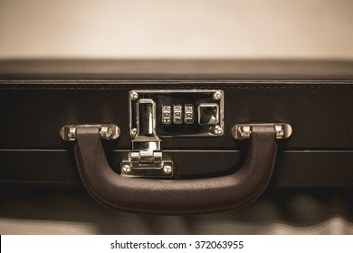 Safty Lock Business Briefcase. Storage and protection of cash and valuable goods. Business man with leather briefcase. Money and documents in bag.