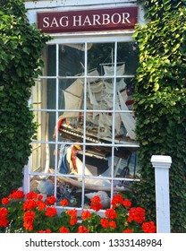 Sag Harbor, NY, USA June 27, 2017 A model of a whaling boat hangs in the window of a store in downtown Sag Harbor, New York