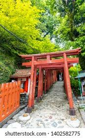 Saga, Japan - May 1, 2019 -  Torii (Japanese red wooden gate) of  Yutoku Inari Shrine  is the third largest of Japanese architecture temple dedicated to Inari in Kashima city, Saga, Japan.