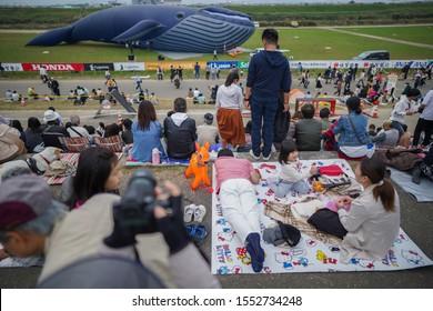Saga, Japan - Nov. 3, 2019: Unidentified local Japanese are seen relaxing during Saga International Balloon Fiesta. Over 300,000 of public attendants coming to this balloon fiesta.