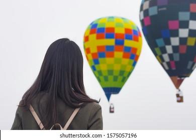 Saga, Japan - Nov. 3, 2019: Unidentified public spectator is seen seeing of balloon during Saga International Balloon Fiesta. Over 300,000 of public attendants coming to this balloon fiesta.