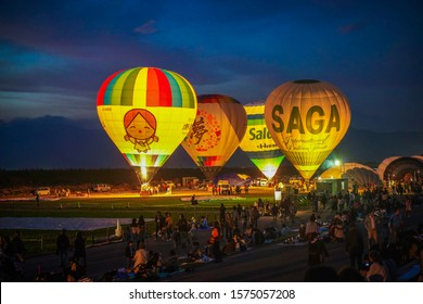 Saga, Japan - Nov. 3, 2019: Hot air balloons are seen during La Montgolfier Nocturne of Saga International Balloon Fiesta. Over 300,000 of public attendants coming to this fiesta. (Noise is visible)