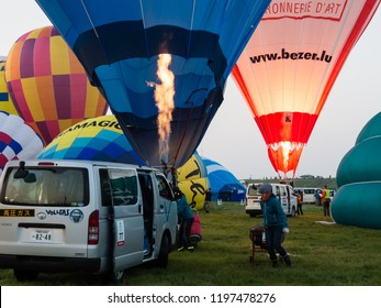 Saga, Japan - November 4, 2016: Hot air balloon crews getting ready for take off during Saga International Balloon Fiesta