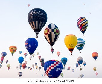Saga, Japan - November 4, 2016: Dozens of hot air balloons in the sky during early morning competition at Saga International Balloon Fiesta