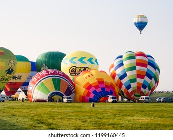 Saga, Japan - November 4, 2016: Hot air balloons inflating and taking off during Saga International Balloon Fiesta