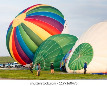 Saga, Japan - November 4, 2016: Hot air balloons inflating and getting ready for take off during Saga International Balloon Fiesta
