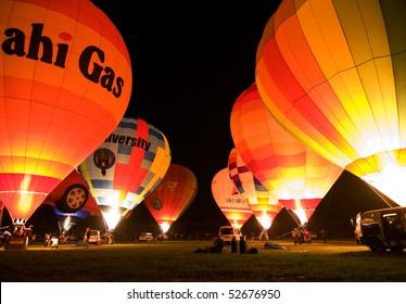 SAGA, JAPAN -NOVEMBER 4: Hot air balloons light up in unison for the  night glow at the yearly Saga Balloon Festival November 4, 2006 in Saga, Japan.