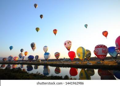Saga, Japan - November 5, 2017: SAGA International Balloon Fiesta in Saga, Japan. Hot air balloons starting their flight at early morning.
