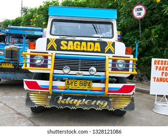 Sagada, Mountain Province, Philippines - November 24, 2016: Front view of a Philippine Jeepney with design of Sagada parking at a loading zone