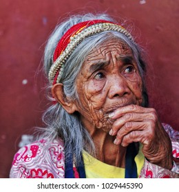 Sagada, Philippines-October 10, 2016: Some old women of the Igorot hill tribe still wear snake bone headdresses like this one at the local bus sation. Mountain province-Cordillera region-Luzon island.