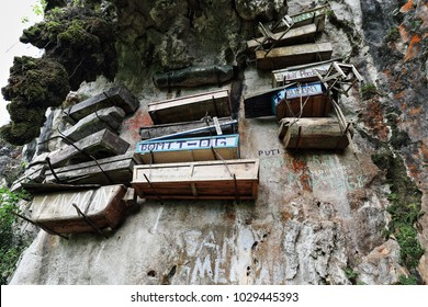 Sagada, Philippines-October 9, 2016: The Igorots practice unique funerary customs-the dead are buried in coffins tied or nailed to cliffs. Sagada-Mountain province-Cordillera region-Luzon-Philippines.