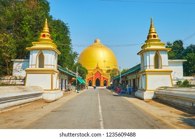 SAGAING, MYANMAR - FEBRUARY 21, 2018: The Southern gate of Kaunghmudaw Pagoda with a small market stalls on the both sides of the alley, on February 21 in Sagaing