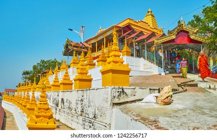 SAGAING, MYANMAR - FEBRUARY 21, 2018: The lines of golden stupas in site of U Min Thonze Caves, the covered staircase behind the shrine leads to the top of Sagaing hill, on February 21 in Sagaing