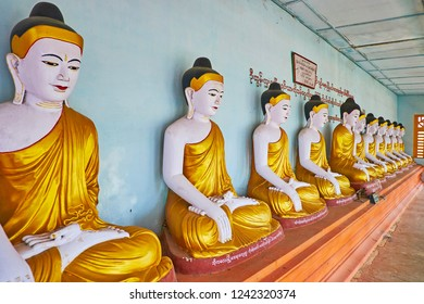 SAGAING, MYANMAR - FEBRUARY 21, 2018: The prayer hall of Image House of U Min Thonze Temple with statues of Lord Buddha in golden robes, on February 21 in Sagaing