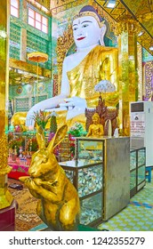 SAGAING, MYANMAR - FEBRUARY 21, 2018: Sculpture of rabbit in Image House of Soon Oo Ponya Shin Paya (Summit Pagoda) is believed to bring luck for people, rubbing it, on February 21 in Sagaing