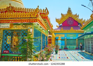 SAGAING, MYANMAR - FEBRUARY 21, 2018: The shrines in Soon Oo Ponya Shin Paya (Summit Pagoda) with carved pyatthat roofs and colorful decorative window grilles, on February 21 in Sagaing
