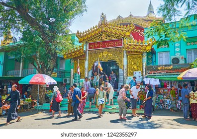 SAGAING, MYANMAR - FEBRUARY 21, 2018: The crowd of tourists at the carved porch of Soon Oo Ponya Shin Pagoda (Summit Pagoda) and its souvenir market, on February 21 in Sagaing