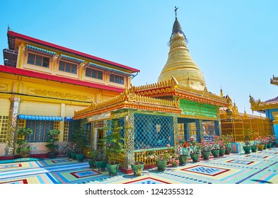 SAGAING, MYANMAR - FEBRUARY 21, 2018: The golden stupa of Soon Oo Ponya Shin Paya (Summit Pagoda) is surrounded by small Shrines and Image Houses, on February 21 in Sagaing