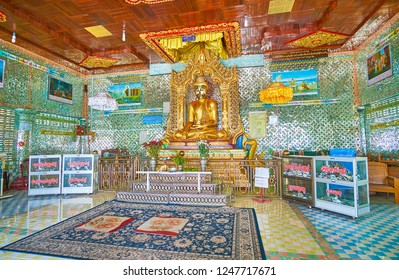 SAGAING, MYANMAR - FEBRUARY 21, 2018: Interior of Image House of Soon Oo Ponya Shin Paya (Summit Pagoda) with complex shiny mirror patterns and golden statue of Lord Buddha, on February 21 in Sagaing