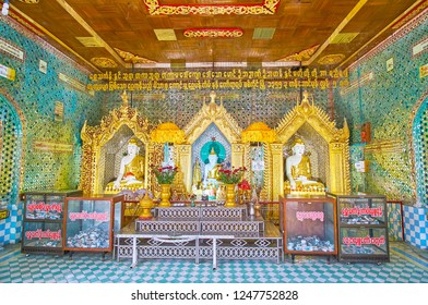 SAGAING, MYANMAR - FEBRUARY 21, 2018: The richly decorated Image House of Soon Oo Ponya Shin Paya (Summit Pagoda) with Buddha statues at the altar and fine mirror ornaments, on February 21 in Sagaing