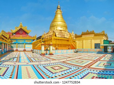 SAGAING, MYANMAR - FEBRUARY 21, 2018: The courtyard of medieval Soon Oo Ponya Shin Paya (Summit Pagoda) with colored patterns on the floor, gilt stupa and numerous shrines, on February 21 in Sagaing.