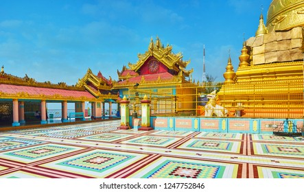 SAGAING, MYANMAR - FEBRUARY 21, 2018: Soon Oo Ponya Shin Paya boasts traditional Burmese architecture with authentic pyatthat roofs, shady hallway and colorful patterns, on February 21 in Sagaing