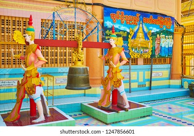 SAGAING, MYANMAR - FEBRUARY 21, 2018: The scenic bell, hanging on two statues for bell ringing ritual in courtyard of Soon Oo Ponya Shin Paya (Summit Pagoda), on February 21 in Sagaing