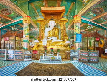SAGAING, MYANMAR - FEBRUARY 21, 2018: Panorama of Soon Oo Ponya Shin Paya (Summit Pagoda) with statue of Buddha Touching Earth, surrounded by rich decors and Nagar dragons, on February 21 in Sagaing.