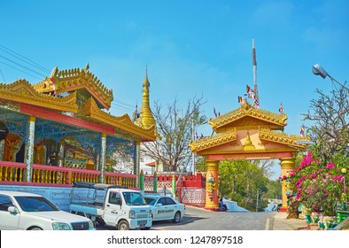 SAGAING, MYANMAR - FEBRUARY 21, 2018: The scenic gate of Soon Oo Ponya Shin Paya (Summit Pagoda) with painted and carved decorations, on February 21 in Sagaing